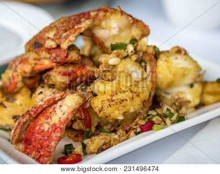 Salt And Pepper Deep Fried Lobster Pieces Served On A Plate, Becoming Popular In More And More Overs