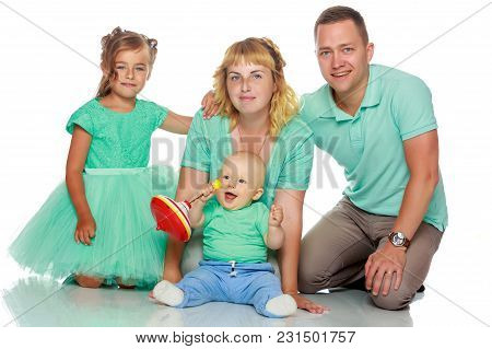 Happy Family With Young Children. The Concept Of Family Happiness And Development Of Children. Isola