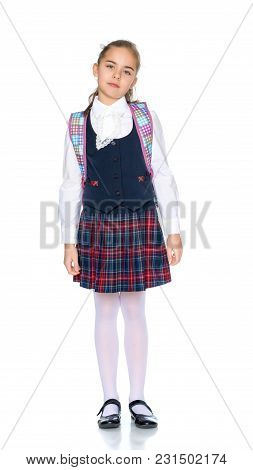 Beautiful Little Girl In A School Uniform On A White Background. The Concept Of Style And Fashion, A