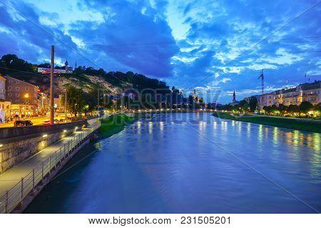 Salzburg, Austria - September 6 2017;  Night View Along Salzach River In Long Exposure Dark Cloudy S