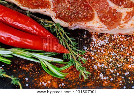 Top View Of A Raw Beef Steak Seasoned With Sea Salt And Pepper On Fresh Raw Beef Steak On Wooden Cut