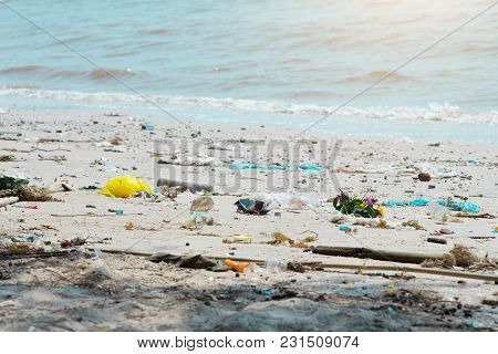 Garbage On The Beach Is Polluting The Waste.