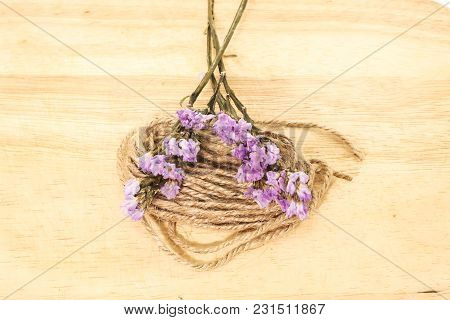 Close Up Single Of Violet Statice Flower Background Use For Decoration On Small Brown Rope Sack