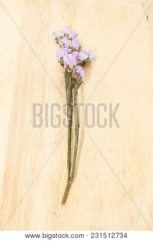 Single Purple Statice Flower Background Use For Decoration On Brown Wooden