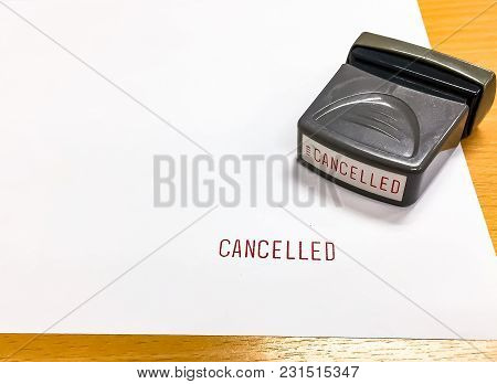 The Red Text, Cancelled Was Stamped With Rubber Stamp On The White Paper