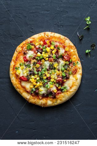 Taco Vegetarian Pizza. Mexican Pizza With Beans, Corn, Jalapeno Pepper, Mozzarella Cheese On A Dark