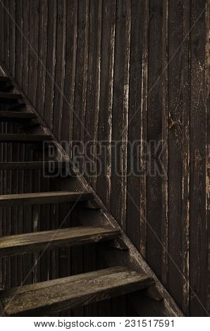 Old Wooden Stairs Against Wooden Wall Of