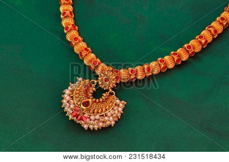 Close View Of Gold Necklace At Pune