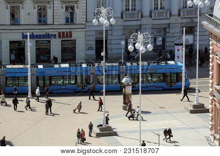 ZAGREB, CROATIA - APRIL 10: Blue city trams on Ban Jelacic square in Zagreb, Croatia on April 10, 2015.