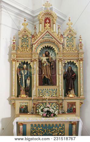 SISAK, CROATIA - DECEMBER 07: Altar of Saint Joseph in the Church of Holy Cross in Sisak, Croatia, on December 07, 2017.