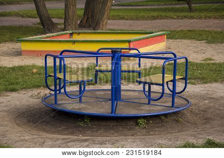 Childrens playground on the yard in summer. Rest with little child