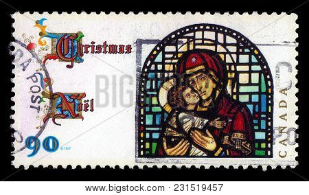 Canada - Circa 1997: A Stamp Printed In Canada Shows Stained Glass Blessed Virgin With Child, Series