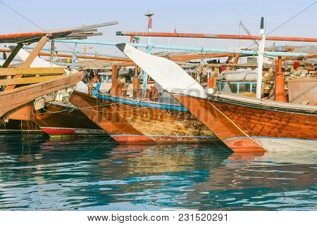 Traditional Wooden Fishing Dhows Berthed In The Dhow Harbour In Abu Dhabi, The Capital City Of The U