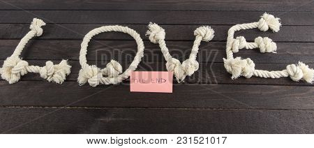 Love Form With Rope And The Word End On Wood Background
