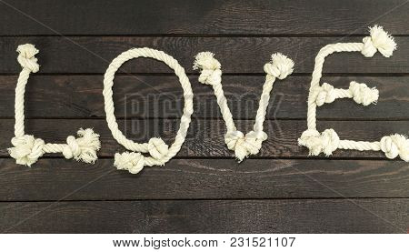 Love Form With Rope On Wood Background