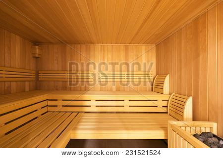 Fornal view of sauna with pebbles. Nobody inside