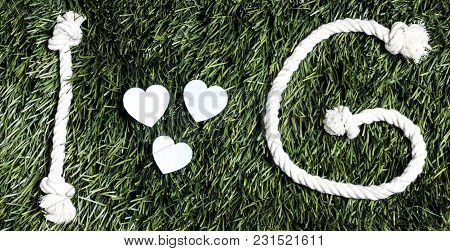 Text: I Love G Made From Ropes On Grass Background