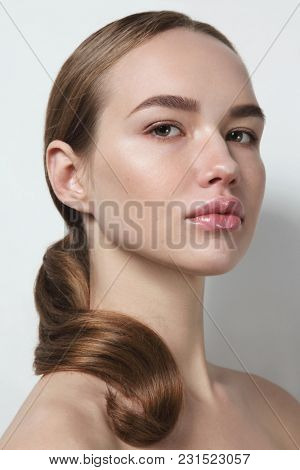 Young beautiful healthy woman with clean make-up
