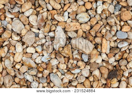 Close Up Pebble Stones. Seamless Tileable Background Texture