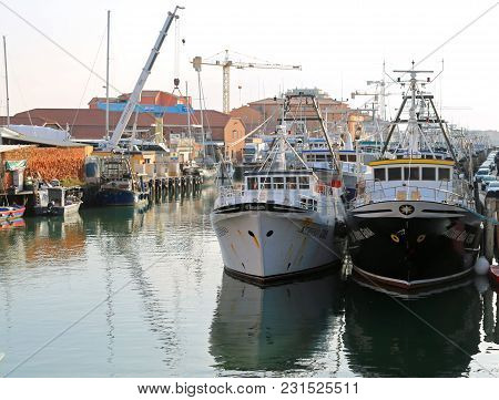 Chioggia, Ve, Italy - February 11, 2018: Large Fishing Boats Moored In The Industrial Port On The Ad