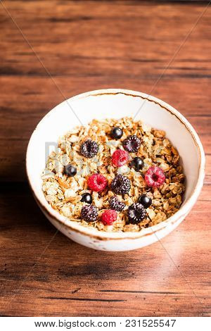 Breakfast Super Bowl Of Homemade Granola Or Muesli With Oat Flakes, Black Currant, Black Raspberry A