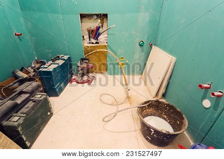 Construction Tools Are Storaged In The Room With Drywall Or Gypsum Plasterboard Walls Of Apartment I