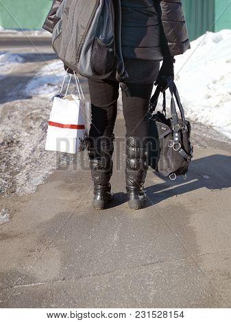 A Woman Carrying Shopping Bag, Rucksack And Handbag, Outdoor Vertical Shot