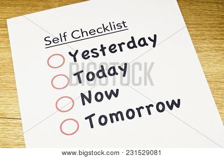 Self Checklist Printed On Paper And Placed On Wooden Floor
