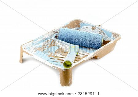 Blue Used Roller Paint Brush On Tray. Isolated On White Background