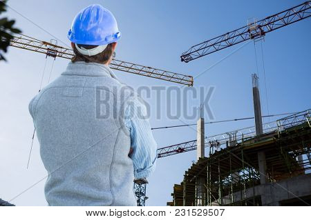 Digital composite of man with helmet standing back to viewer