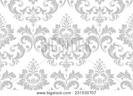 Wallpaper In The Style Of Baroque. A Seamless Vector Background. White And Grey Floral Ornament. Gra
