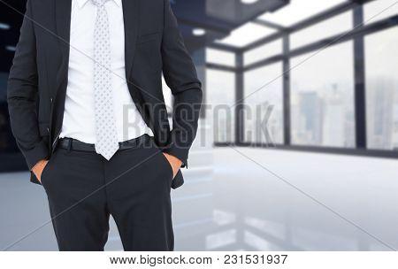 Digital composite of businessman in office