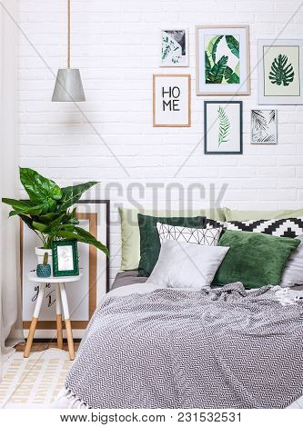 Bedroom Interior In Gray Green Tones With Pictures On A White Wall Vertically