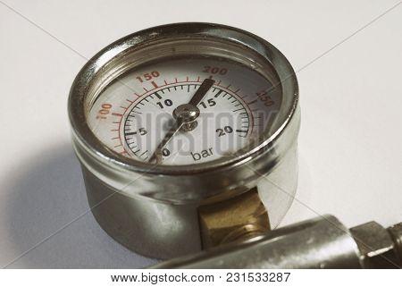 Chromed Gauge High Air Gas Pressure Sensor Meter Close-up White Background.