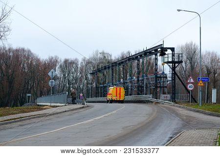 Dobrush, Belarus - November 20, 2017: Hydrotechnical Structure And Bridge On River Iput, Dobrush, Go