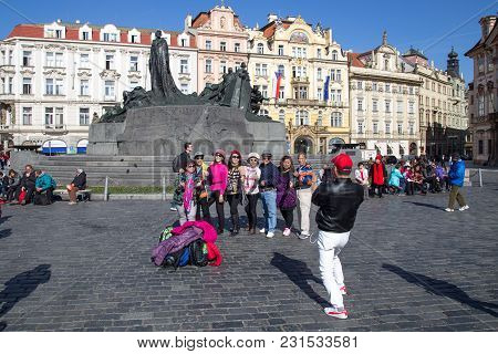 Prague, Czech Republic - March 16, 2017: Group Of Chinese Tourists On Old Town Square In The Histori