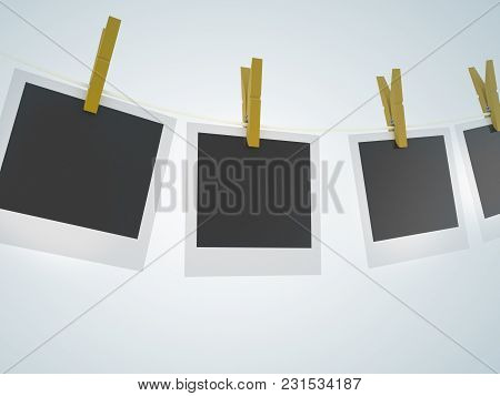 Photo Frames On The Rope And Empty Background