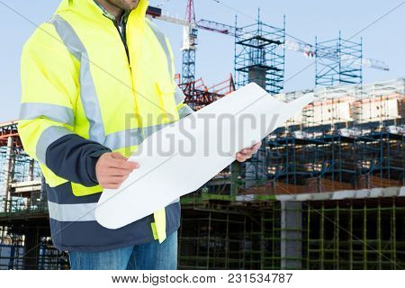 Digital composite of engineer at construction site