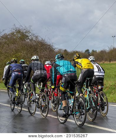 Cernay-la-ville, France - March 5, 2017: Rear Image Of A Group Of Cyclists Riding In The Peloton On