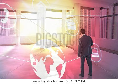 Businessman standing and looking against modern room overlooking city