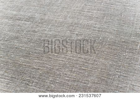 Texture Canvas Fabric Background In Light Brown Beige Color.