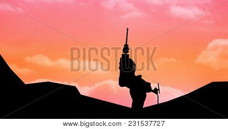 Digital composite of Silhouette hand holding drill machine against sky