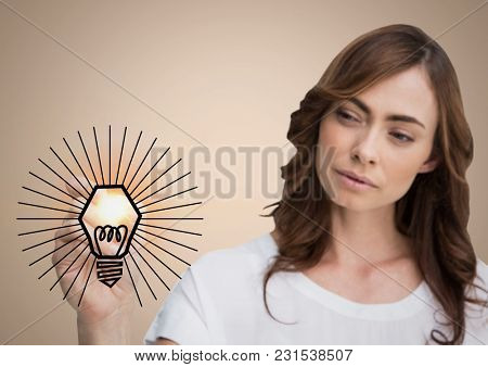 Digital composite of Woman drawing light bulb doodle with flare against cream background