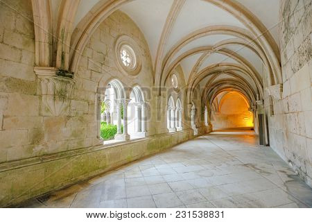 Alcobaca, Portugal - August 15, 2017: Cistercian Architecture Of Corridor With Colonnade Of Mosteiro