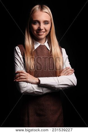 portrait of a confident young business woman. isolated on a dark