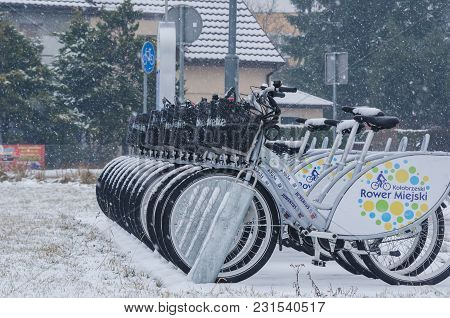Kolobrzeg, West Pomeranian / Poland - 2018: Snow-covered City Bikes In The Dock Are Waiting For User
