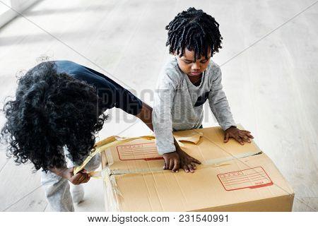 Young boy helping unpack stuff
