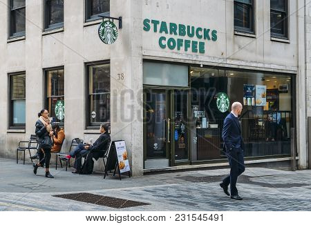 London, Uk- Mar 13, 2018: Office Workers At A Starbucks Store In The City Of London, England, Uk. St