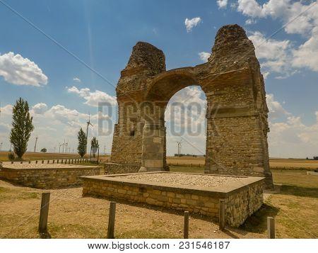 Cloudy Sky Over Old Roman Gate Heidentor At Carnuntum, Austria Europe