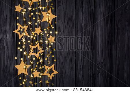 Flat Lay Border Of Big And Small Stars Of Confetti. Golden Beads In The Form Of Stars. Festive Decor